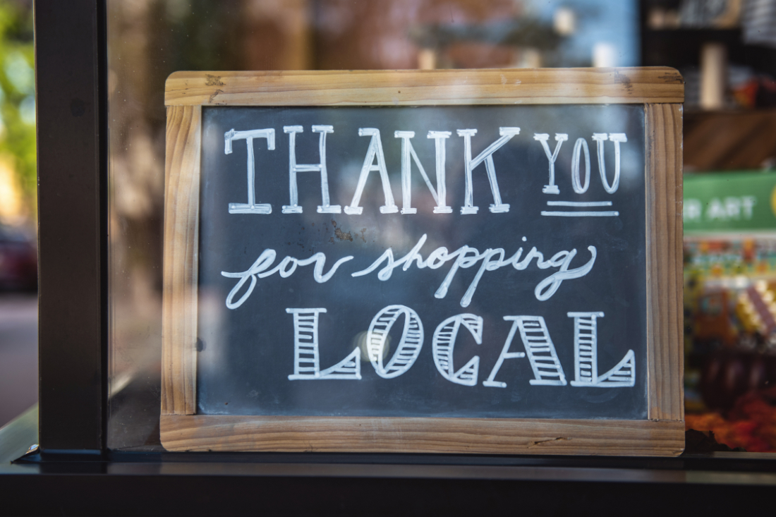 """Chalkboard sign that says """"Thank you for shopping local"""""""
