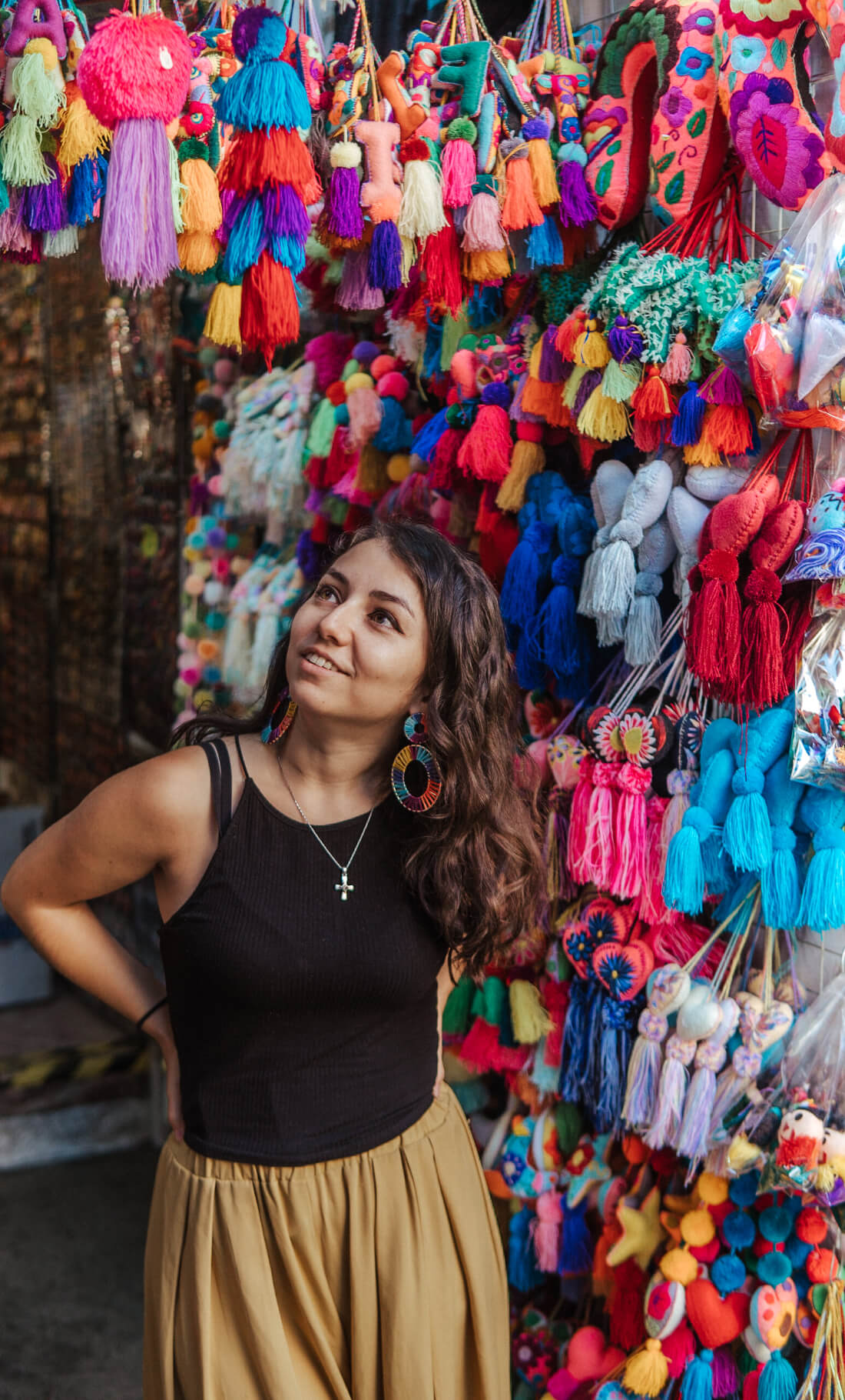 Stacey Valle standing in front of a colorful market vendor display
