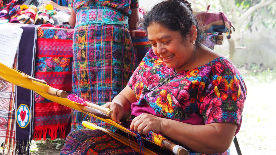 Woman weaving at the women's artisan co-op called Casa Flor Ixcaco in Guatemala