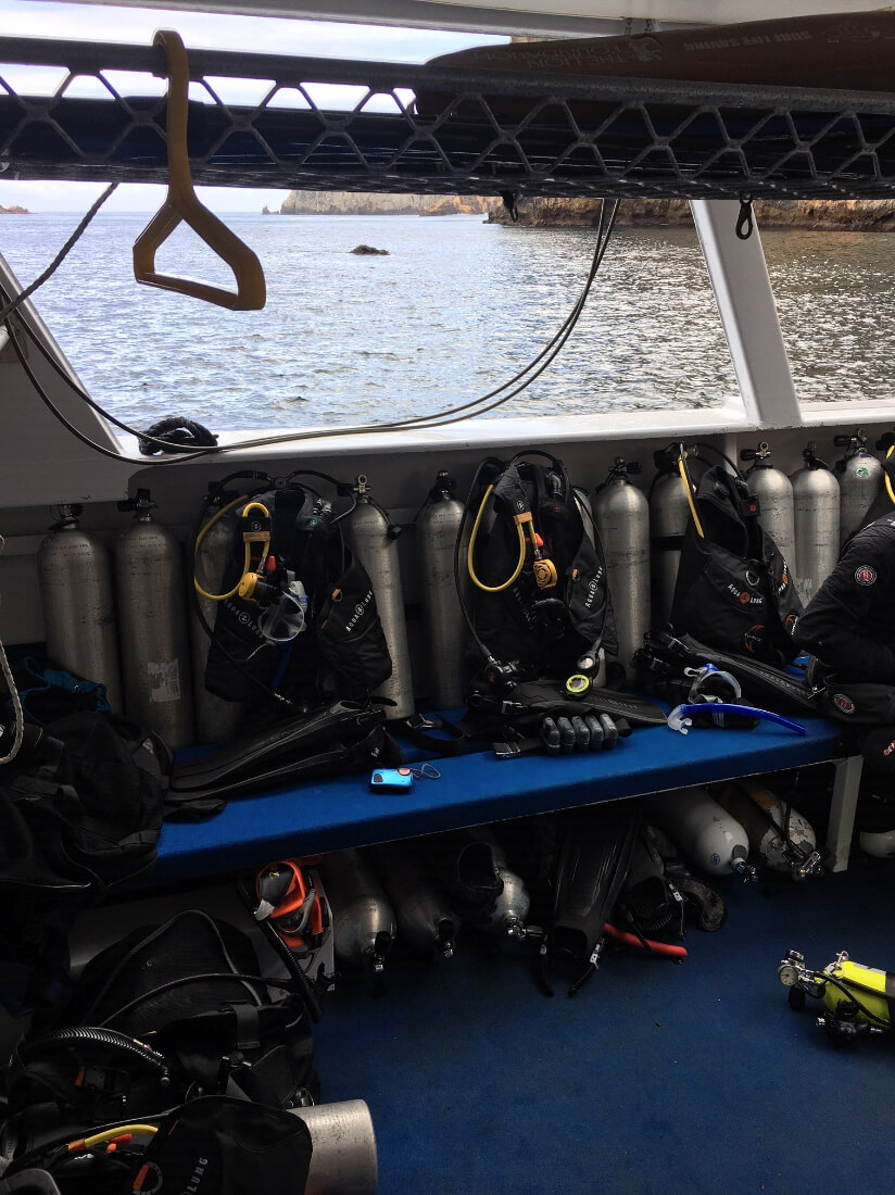 Scuba tanks and gear on a dive boat ready for use