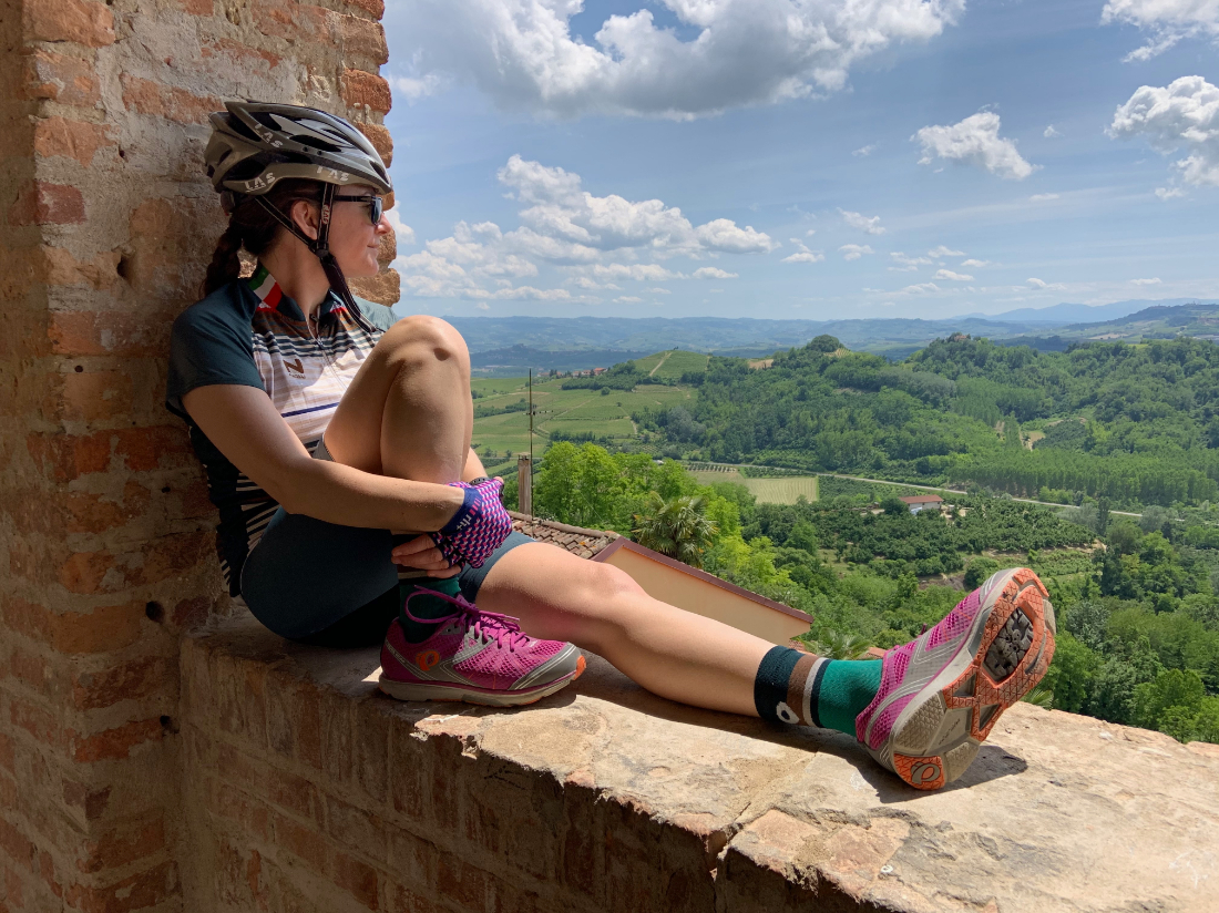 Heather Dowd of Tourissimo cycling tours in Italy overlooking the landscape in cycle gear