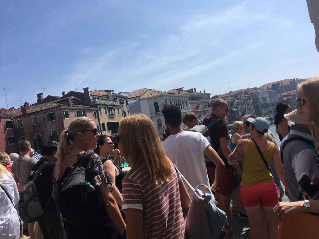 Close-up of the crowds on Rialto Bridge in Venice while traveling to Italy in the summer